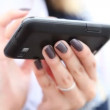 Closeup of hands of woman using cell phone. — Stock Video #48745479
