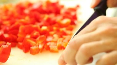 Woman hands with kitchen knife slicing cutting red bell pepper — Stock Video