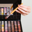 Colorful eyeshadows palette with makeup brush — Stock Photo #48822109