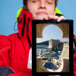 Man showing Dubrovnik in Croatia on tablet — Stock Photo #48822121