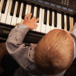 Child  playing on digital keyboard piano synthesizer — Stock Photo #48822125