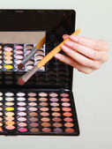 Colorful eyeshadows palette with makeup brush — Stock Photo