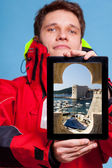Man showing Dubrovnik in Croatia on tablet — Stock Photo