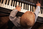 Child  playing on digital keyboard piano synthesizer — Stock Photo