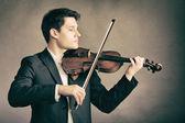 Man violinist playing violin. — Stock Photo