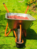 Garden wheelbarrow with sand soil. — Stock Photo