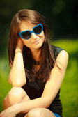 Portrait of woman in blue sunglasses outdoor — Stock Photo