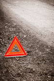 Red warning triangle sign on road — 图库照片