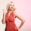Portrait beautiful girl in blond wig and retro red dress — Stock Photo #48964129