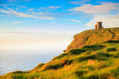 Cliffs of Moher at sunset - O Briens Tower in Co. Clare Ireland Europe. — Stock Photo
