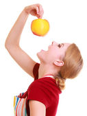 Funny housewife in kitchen apron trying to eat apple — Foto Stock