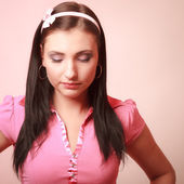 Childish young infantile girl in pink. Longing for childhood. — Stock Photo