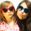 Mother and kid in sunglasses making funny faces — Stock Photo #49347043