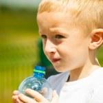 Little boy drink water from bottle — Stock Photo #49347071
