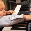 Boy  playing on digital keyboard piano synthesizer — Stock Photo #49347217