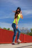 Cool girl skater riding skateboard — Stock Photo