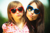 Mother and kid in sunglasses making funny faces — Stock Photo