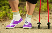 Active woman senior nordic walking — Stock Photo