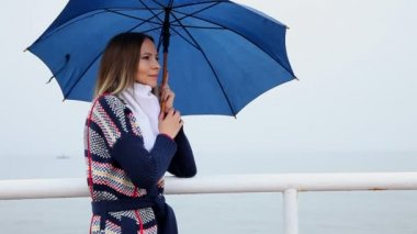 Young woman with blue umbrella — Stock Video