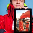 Man sailor showing lifebuoy on tablet. — Stockfoto #49547923