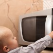 Boy playing with timer of microwave oven — Stock Photo #49547945