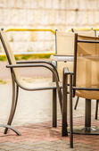 White and black restaurant chairs outdoor. — Stock Photo
