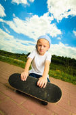 Skater boy child with his skateboard. — Stock Photo