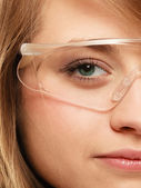 Face of chemist woman in goggles glasses — Stok fotoğraf