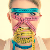 Woman with measure tapes. — Stock Photo