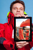 Man sailor showing lifebuoy on tablet. — Stock Photo