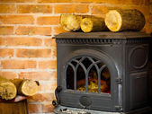 Fireplace with fire and firewood interior — Stock Photo