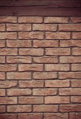 Brick wall with wooden beam background — Stockfoto