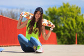 Cool girl skater with skateboard — Stock Photo