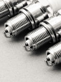 Set of spark plugs as spare part of car. — 图库照片