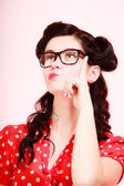 Pensive thoughtful pinup girl in eyeglasses — Stock Photo