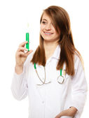 Woman doctor in lab coat with syringe — Stock Photo