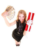 Woman holds christmas gift box and polish money — Stock Photo