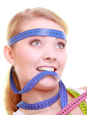 Obsessed girl with violet measure tapes around her head — Stock Photo