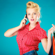 Pinup girl with shopping bags calling on phone — Stock Photo #49907723