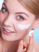 Face of young woman taking care of dry skin. — Stock Photo