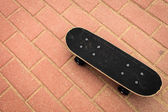Lone skateboard deck on concrete background — Stock Photo