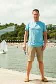 Fashion portrait of handsome man on pier — Stock Photo
