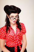 Portrait of pinup girl in eyeglasses — Stock Photo