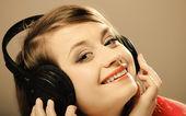 Smiling teen girl in headphones — Stock Photo