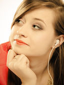 Teen girl in earphones — Stock Photo