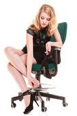 Tired businesswoman massaging feet — Stock Photo