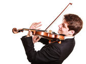 Man violinist playing violin. — Stock Photo