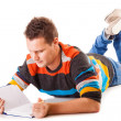 Male student reading a book preparing for exam isolated — Stock Photo #50271901