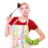 Funny housewife or cook chef in colorful kitchen apron with ladle — Stockfoto