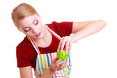 Housewife or chef in kitchen apron using apple timer — Stok fotoğraf